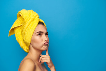 woman with a towel on her head lost in thought