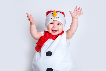 Amazed attractive baby girl in Christmas costume having fun . Close-up portrait little girl in snowman costume