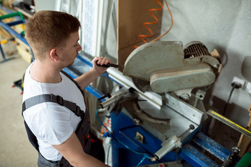 Young worker in windows workshop