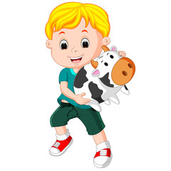 little boy holding cow bank