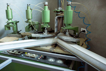 Operating welding machine in factory.