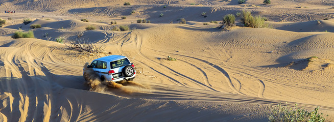 Cars traces on a sand road on the desert, offroad car rally competition