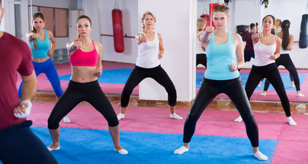 Joyful women are doing self-defence-karate moves