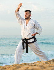 Active guy practising karate kata poses