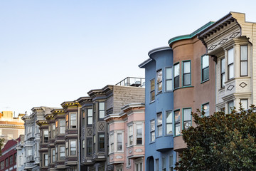 Sunset light shines on a row of colorful buildings on Filbert Street in San Francisco, California