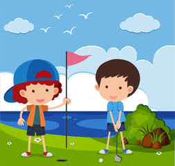 Two boys playing golf in the field