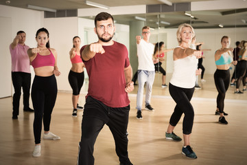 People training at dance class