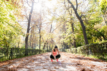 attractive sport woman in runner sportswear breathing gasping and taking a break tired and exhausted after running workout on Autumn park