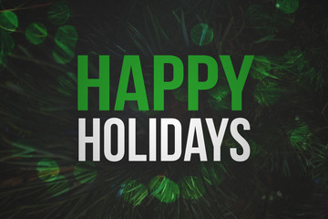 Happy Holidays Text with Pine Branches Background and Green Bokeh Lights