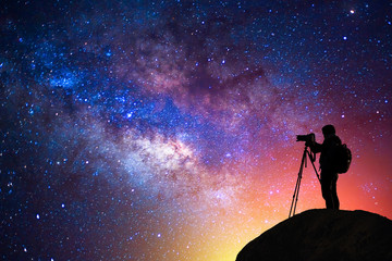 milky way, star, silhouette happy camera man on the mountain with detail of the milky way