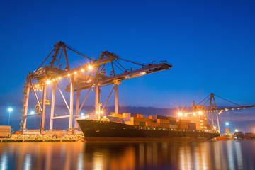 Shipping terminal and logistics yard at twilight.