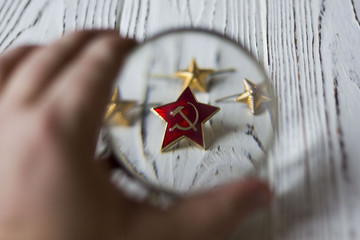 icon hammer and sickle and star on a wooden table