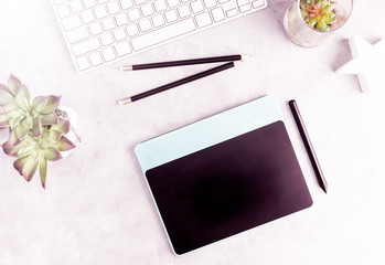 Top view flat lay graphic tablet on grey office table. Modern designer's work place concept. Text space
