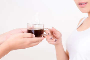 Barista giving cup of coffee to young asia woman. . Isolated on white background. Studio lighting. Concept for healthy.