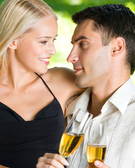 Young happy couple with champagne, outdoor