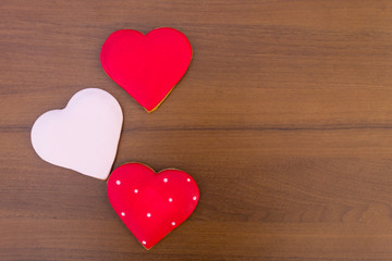 Heart shaped cookies for valentine day on wooden table