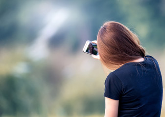young woman is making selfie photo with smartphone..