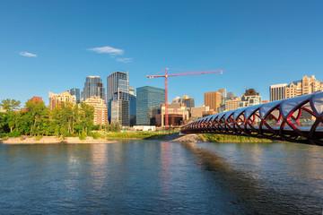 Calgary skyline and Peace Bridge at sunset - Calgary, Alberta, Canada.