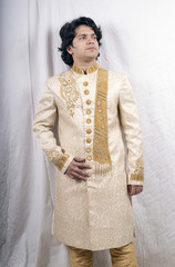 indian male model wearing sherwani