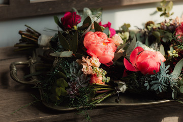 pink flowers on a wooden bench