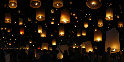 flying candle during Loy krathong festival , Chiang mai , Thailand