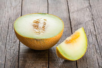 Sliced melon on wooden table