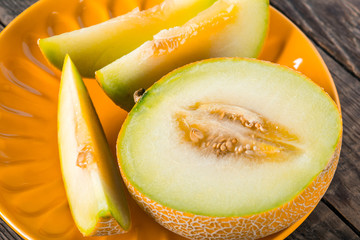 Sliced melon on plate