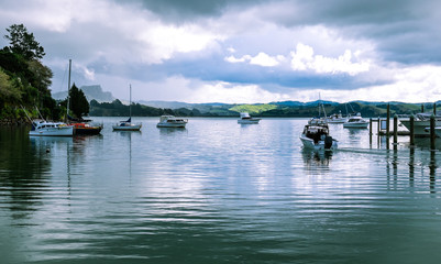Motor launch motoring out of Whangaroa Harbour marina, Far North, Northland, New Zealand, NZ, on a winter day