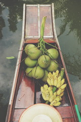 Close up of coconut fruit and banana on the boat