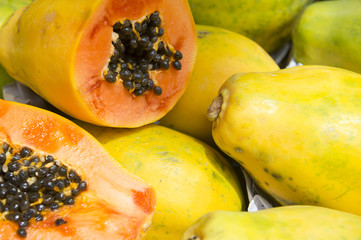 Fresh cut juicy tropical papaya mamao fruit with seeds at Brazilian farmers market in Rio de Janeiro Brazil