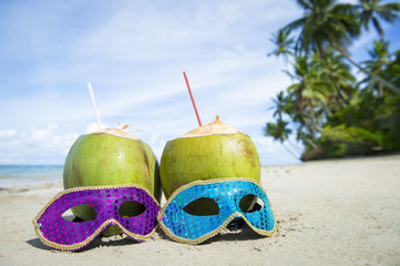 Poster Carnaval Colorful sequined carnival masks and fresh green coconut drinks on a palm fringed beach in Brazil.