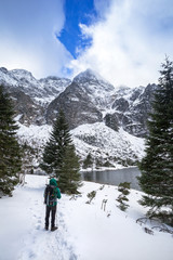 Man with backpack trekking in Tatra mountains, Poland