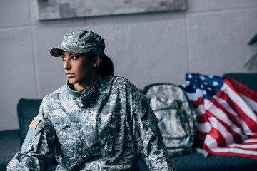 female soldier and american flag