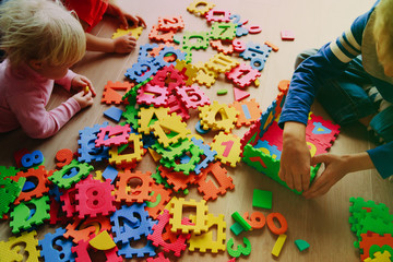 kids playing with puzzle, learning concept