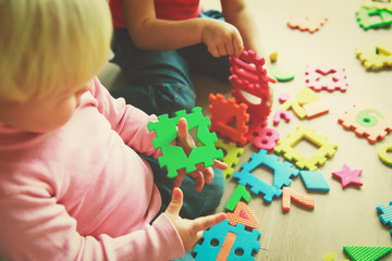 kids playing with puzzle, learning shapes and numbers