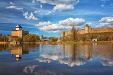 Narva Herman castle and Ivangorod fortress stand on banks of Narva river. Medieval fortifications on Estonian-Russian state border.