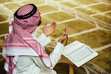 muslim man praying inside the mosque