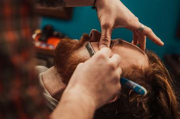 Hipster shears a beard