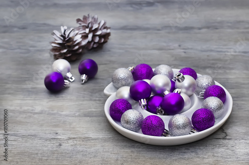 Silver And Purple Decorative Balls On A Gray Background Concept Of Delectable Purple Decorative Balls