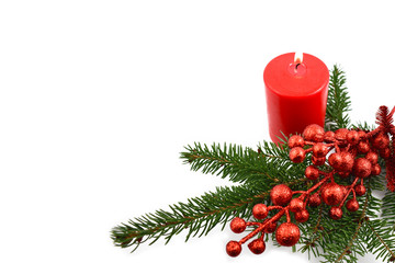 Christmas candle with spruce twig stock images. Red candle with twig. Christmas decoration photography. Red christmas decoration on a white background