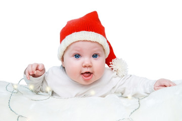 Funny baby in a red Santa hat.