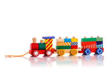 Wooden toy train with colorful blocks isolated over white background