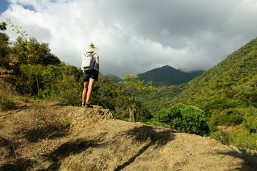Tourist no the trail for the highest peak on Cuba Pico Turquino being in a mountain range Sierra Maestra on Cuba