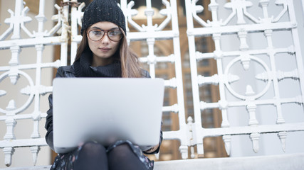 Young woman using laptop in outdoors