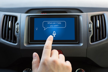 Man hand touching to multimedia system with app personal assistant