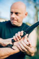 Knife vs knife. Kapap instructor demonstrates fighting and disarming technique