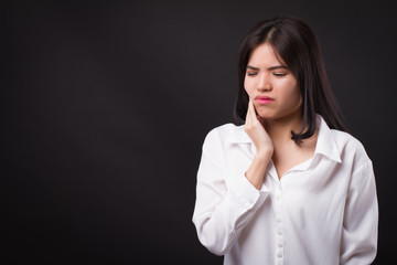 painful woman with toothache, tooth decay, sensitivity