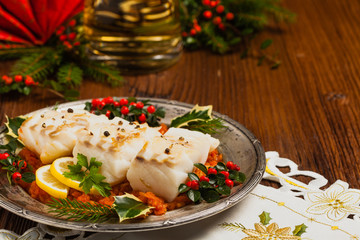 Christmas fish. Roasted cod pieces, served in vegetable sauce.