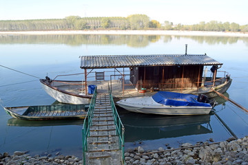 An old fishing boat moored on the river Po - Italy