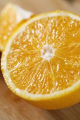 Orange closeup on wooden boards. Orange cut in half. Cross section.